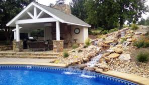 Outdoor Livingroom Outside Fireplace And Pool Outdoor Living Room Pool Waterfall