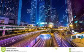 night view of modern city traffic across street time lapse hong