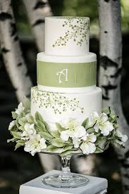 wedding cake green this white wedding cake with green floral designs is a beautiful