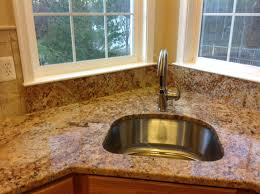 Baltic Brown Granite Countertops With Light Tan Backsplash by Backsplashes For Granite Countertops Ideas