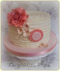 ridge buttercream cake with large peach rose very simple cake to