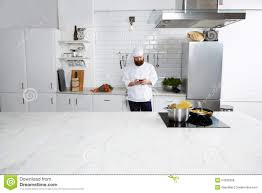 big modern kitchens experienced male chef cook standing on big modern kitchen while
