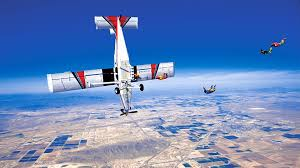 skydivers catch airplane