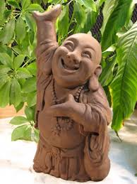 laughing buddha statue tree