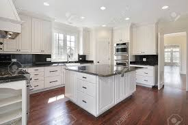 kitchen in luxury home with marble island stock photo picture and