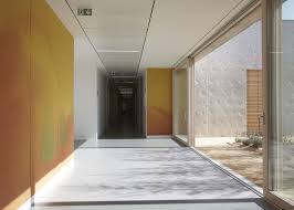 epilepsy care home by atelier martel features concrete walls