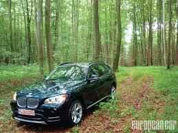 dark green bmw 2013 bmw x1 first drive european car magazine