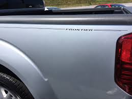 nissan frontier logo factory style pinstripes for dealers nissan kits