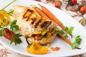 up of plate with fresh grilled stuffed chicken and