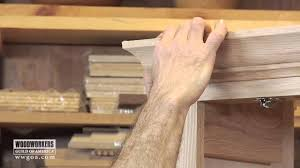 woodworking diy project installing crown molding on a cabinet