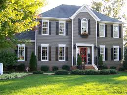 Black Shutter Accenting This Grey House With Black Dark Shutters Is A Perfect