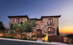 decor tuscan style homes with crumbling stone wall and casement