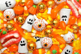 halloween candy background halloween background of mixed candies orange color theme stock