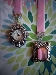 what compliments pink this bookmark was made with repurposed vintage jewelry one end has