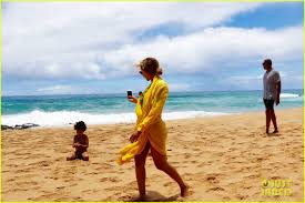 beyonce sports swimsuit for family vacation in hawaii photo