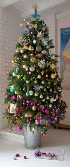 tree decorated with layers of colour baubles of
