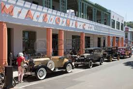 classic vintage cars outside the masonic hotel in the art deco