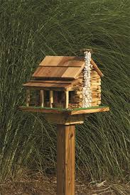 wooden log cabin log cabin garden bird feeder with rock chimney