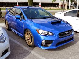 blue subaru gold rims shifting gears car show highlights