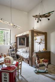 chambre kid four poster canopy bed farmhouse with airplants bastide