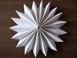 diy paper pinwheel christmas decorations around the houses