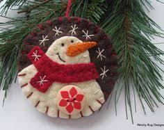 ivory wool felt snowman ornament by woollybugdesigns