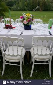 elegant dinner party in a garden in summer in south of france
