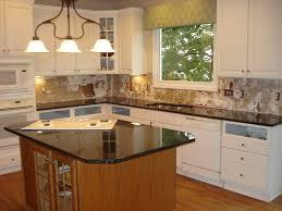 contemporary kitchen with black sleek granite countertops white