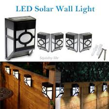 Solar Powered Wall Lights Uk - 4x led solar powered door fence wall lights outdoor garden shed