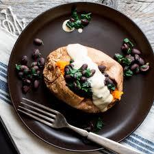 stuffed sweet potato with hummus dressing recipe eatingwell