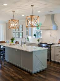 fixer upper the takeaways though warm wood tones with black find this pin and more budget kitchen remodel