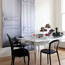 classic dining room ambiance with gloosy silver table with black