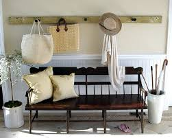 traditional entry with rustic coat rack rustic wood bench cream