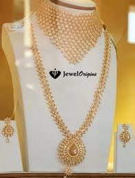 long gold necklace sets images Gold necklace set studded with cz stones jpg