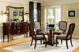 dining room set with white leather chairs and glass table top with