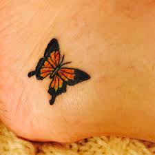 small simple monarch butterfly tattoo on lower ankle tattoo