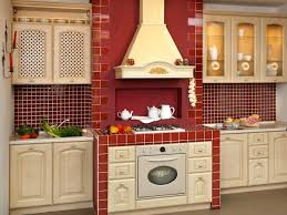 cream wooden kitchen cabinet and red mozaic tile backsplash