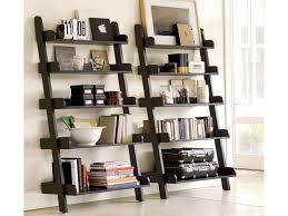 black wooden shelves laid on the wall with many shelves for books