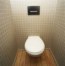 gray bathroom wall tile toilet wooden laminate flooring vintage