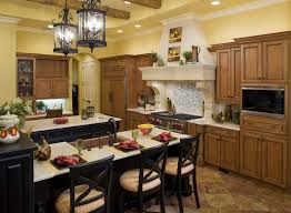 the kitchen has a liquid stone hood faux wood beams and a