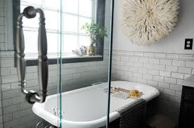 white beveled subway tile bathroom shower head and hand shower