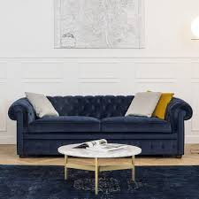canapé chesterfield velours un canapé chesterfield en velours bleu convertible contemporain