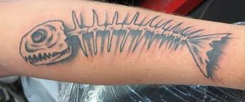 saints and scholars tattoos fish skeleton