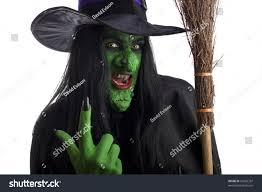 halloween costumes with white background green witch holding her broomstick signaling stock photo 81066337