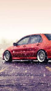 mitsubishi lancer wallpaper phone download 720x1280 mitsubishi lancer evo red snow side view