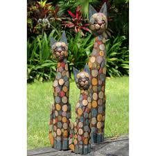 fairtrade set of funky wooden cat statues a also garden