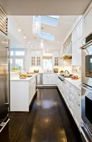 White Kitchen Cabinets With Dark Floors White Cabinets Black Counter Black Island White Counter Dark