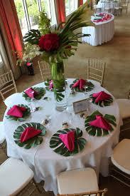 monstera leaf tropical reception wedding flowers wedding decor