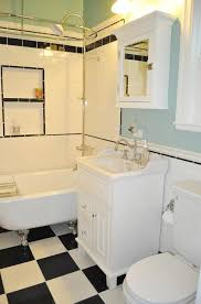 over door mirror jewelry armoire tile shower with bench toilet and