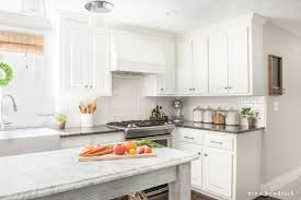is it better to paint or spray kitchen cabinets how to paint oak cabinets and hide the grain step by step